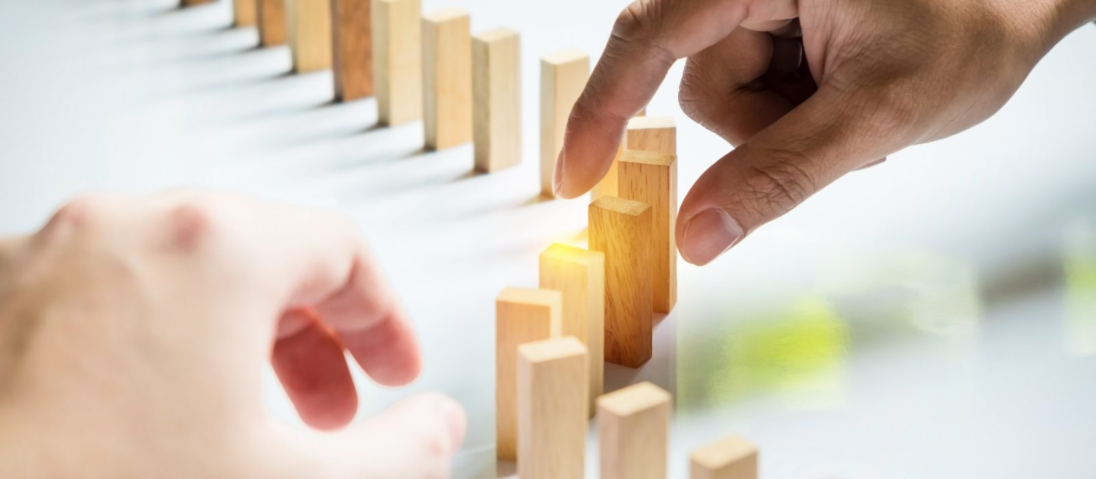 Place a wooden block lines Business team solving a problem.
