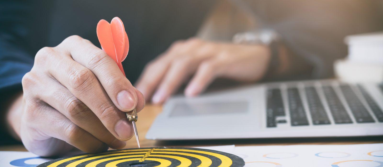 Businessman holding red dart push on target. Business strategy planning success target goals. Business development concept